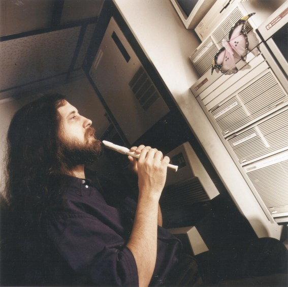 Stallman playing music to the butterfly under the